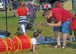 Photo by Tim Kalinowski- Jason Ottenbreit and son, Mason share in some family fun at the Canada Day celebrations at Lions Park in Redcliff.