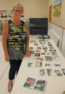 Photo by Jamie Rieger- Gail Lane shows a table displaying vintage photos of Gladys.